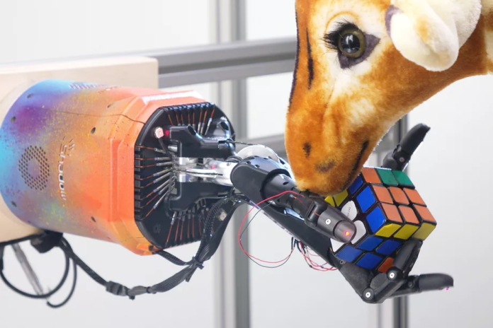 Watch this robot solve a Rubik's Cube one-handed