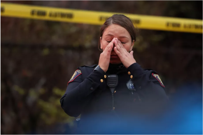 police officer reacts at the scene of a mass shooting