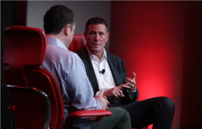 Disney's Kevin Mayer onstage with Recode's Peter Kafka